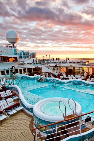 Pool deck of a cruise ship at sunset