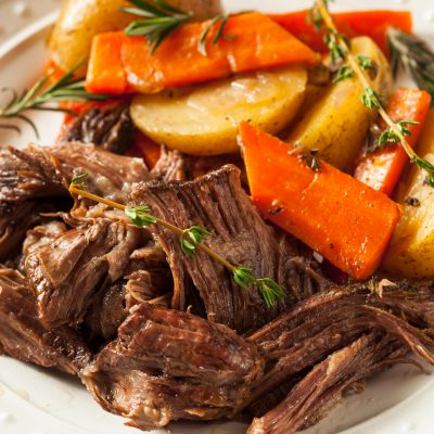 roast beef dinner with carrots and potatoes